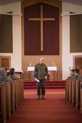Rear Admiral Brent W. Scott speaks to Marines in the chapel aboard Marine Corps Air Station Beaufort Feb. 3. While aboard the air station, Scott spoke with Marines from Aircraft Rescue and Firefighting and Marine Aircraft Group 31. Scott is the 19th Chaplain of the United States Marine Corps and the Deputy Chief of Navy Chaplains. The Marines are with MAG-31.