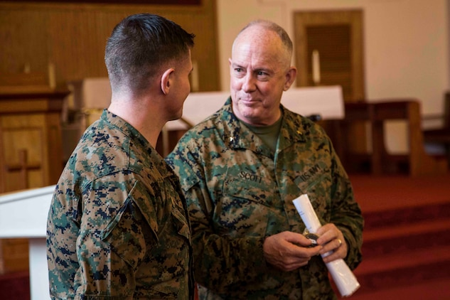 Rear Admiral Brent W. Scott speaks to a Marine in the chapel aboard Marine Corps Air Station Beaufort Feb. 3. Chaplains are religious and spiritual leaders who speak to their Marines on a personal level. Scott gave time for Marines to ask him direct questions at the end of each talk he gave. This allowed them to relate to him directly and bring up topics they were interested in. Scott is the 19th Chaplain of the United States Marine Corps and the Deputy Chief of Navy Chaplains. The Marine is with Marine Aircraft Group 31.
