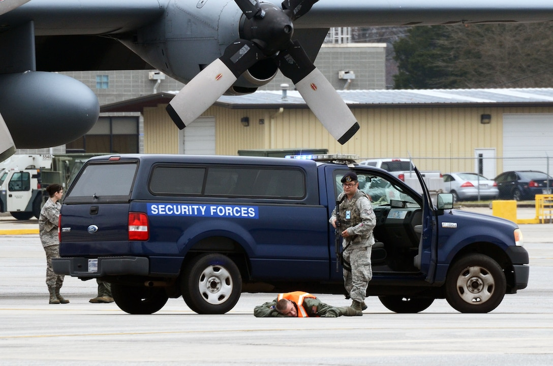 Staff Sgt. William Burke from the 94th Security Forces Squadron apprehends an alleged hijacker during a mock anti-hijacking exercise conducted on Dobbins Air Reserve Base, Ga. Feb. 1, 2016. The scenario, a disgruntled aircrew member attempted to hijack a C-130 Hercules and its crew, from the 700th Airlift Squadron and 94th Aeromedical Evacuation Squadron. An unauthorized engine start alerted maintenance and air traffic control tower personnel of the attempt. (U.S. Air Force photo/Don Peek)
