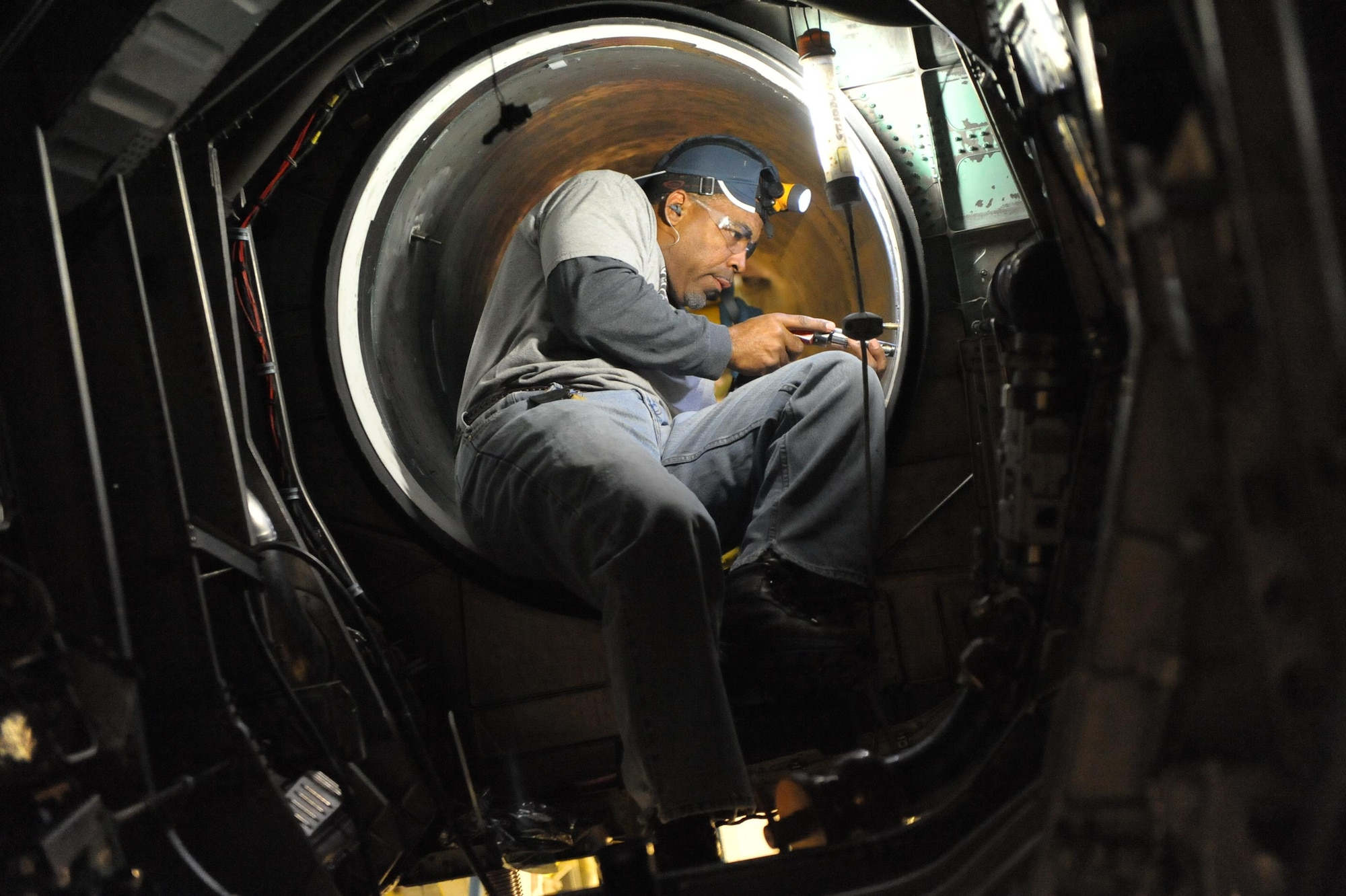 Anthony Farrow, of the 561st Aircraft Maintenance Squadron Production Support, changes intake fasteners on an F-15 Eagle during programmed depot maintenance at Robins Air Force Base, Ga. Thanks, in part, to the diligence of the base's employees, F-15 pilots are able to provide aerial security above Levi's Stadium in Santa Clara, Calif., during Super Bowl 50 on Feb. 7, 2016. (U.S. Air Force photo/Ray Crayton)