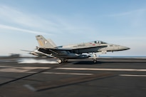 A U.S. Navy F/A-18C Hornet, assigned to Strike Fighter Squadron 83, lands on the flight deck of aircraft carrier USS Harry S. Truman at sea in the Persian Gulf, Feb. 2, 2016. The Truman Carrier Strike Group is deployed in support of Operation Inherent Resolve. U.S. Navy photo by Seaman Lindsay A. Preston