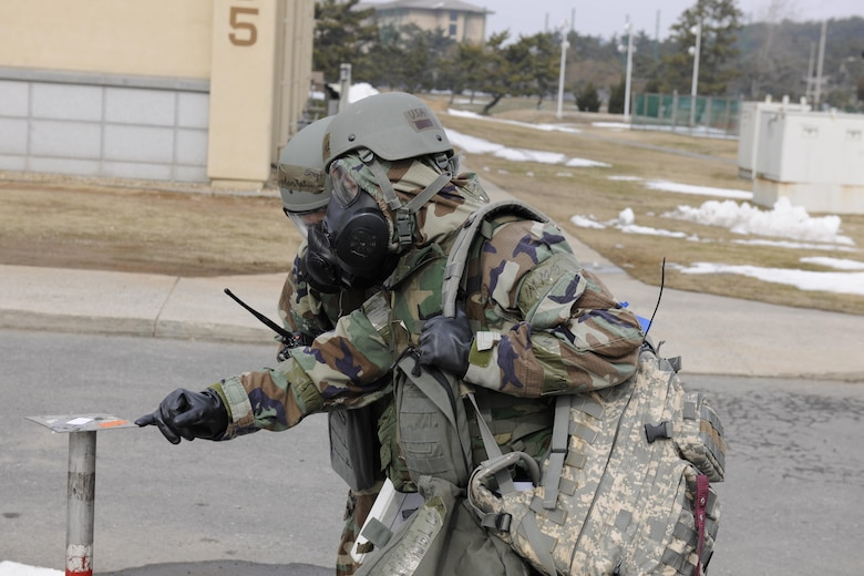 Airmen from the 8th Fighter Wing conduct a post attack reconnaissance sweep after a simulated ground attack during Beverly Pack 16-1, Feb. 4, 2016. The exercise was designed to test the readiness of Airmen with situations they would potentially encounter in a real-world wartime scenario. (U.S. Air Force photo by Senior Airman Dustin King/Released)
