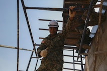 Malaysia Armed Forces Lance Cpl. Mohamad Nizam, plumber, with 7th Squadron Royal Engineer Regiment, poses for a photo during the construction of a community center at Ban Sa Yai School, in Trat, Thailand, during exercise Cobra Gold, Feb. 3, 2016. Cobra Gold 2016, in its 35th iteration, includes a specific focus on humanitarian civic action, community engagement, and medical activities conducted during the exercise to support the needs and humanitarian interests of civilian populations around the region.
