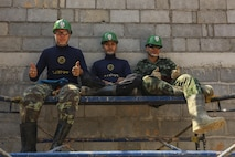Service members from the Royal Thai Armed Forces pose for a photo during the building of a community center at Ban Sa Yai School, in Trat, Thailand, during exercise Cobra Gold, Feb. 3, 2016. Cobra Gold 2016, in its 35th iteration, includes a specific focus on humanitarian civic action, community engagement, and medical activities conducted during the exercise to support the needs and humanitarian interests of civilian populations around the region.