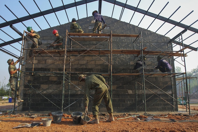 U.S. Marines work with Thai and Japanese service members to build a multipurpose room at Ban Cham Kho School in Rayong, Thailand, Feb. 4, 2016, during exercise Cobra Gold. Marine Corps photo by Sgt. William L. Holdaway