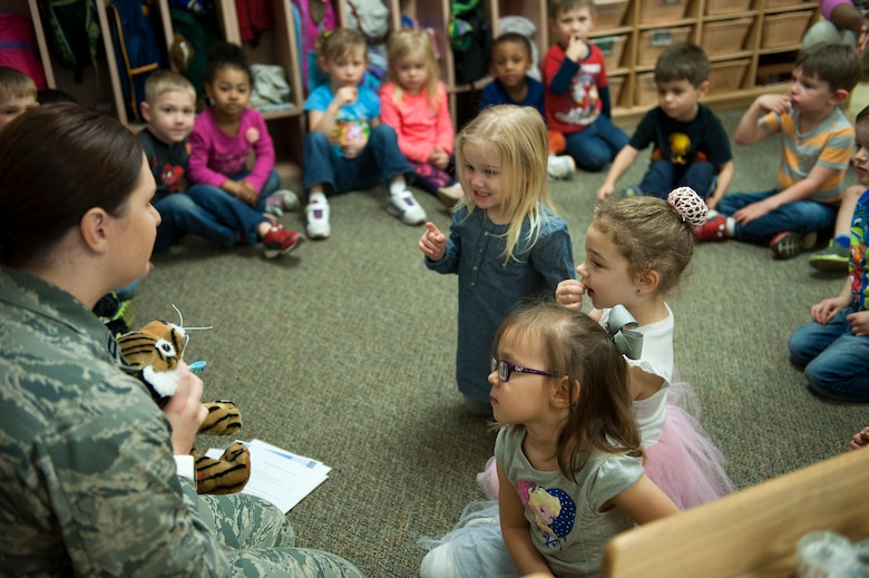 U.S. Air Force Capt. Christianna Moore, 23d Aerospace Medical Squadron general dentist, speaks to children during National Children's Dental Health Month, Feb. 2, 2016, at Moody Air Force Base, Ga. Moore, along with two fellow dentists and a dental assistant, spoke with approximately 100 kids about dental hygiene. (U.S. Air Force photo by Airman 1st Class Kathleen D. Bryant/Released)
