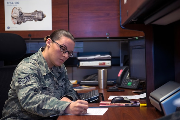 U.S. Air Force Staff Sgt. Amanda Griggs, 23d Maintenance Operations Flight engine management engine manager, documents debrief recap paperwork information, Feb. 5, 2016, at Moody Air Force Base, Ga. Griggs is responsible for viewing engine flight operations and performances that help determine possible additional maintenance based on engine performance. (U.S. Air Force photo by Airman 1st Class Greg Nash/Released)