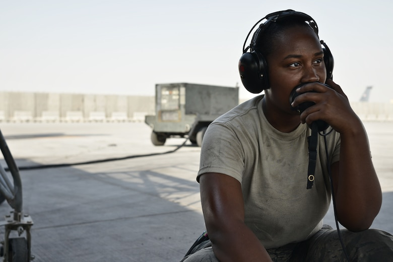 Airman 1st Class Sade, 28th Aircraft Maintenance Squadron crew chief, listens to another crew chief inside a B-1 bomber while completing operation checks during post-flight inspections Sept. 22, 2015 at Al Udeid Air Base, Qatar. Sade was deployed out of Ellsworth Air Force Base, S.D. (U.S. Air Force photo by Staff Sgt. Alexandre Montes/Released)