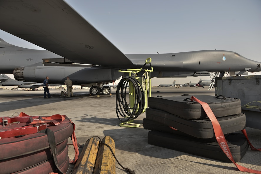 Tech. Sgt. Nasir and Airman 1st Class James, 28th Aircraft Maintenance Squadron crew chiefs, check several sections of a B-1 bomber as part of their final inspection to ready the aircraft before an aircrew boards for a mission Sept. 22, 2015 at Al Udeid Air Base, Qatar. Nasir and James were deployed from Ellsworth Air Force Base, S.D. (U.S. Air Force photo by Staff Sgt. Alexandre Montes/Released)