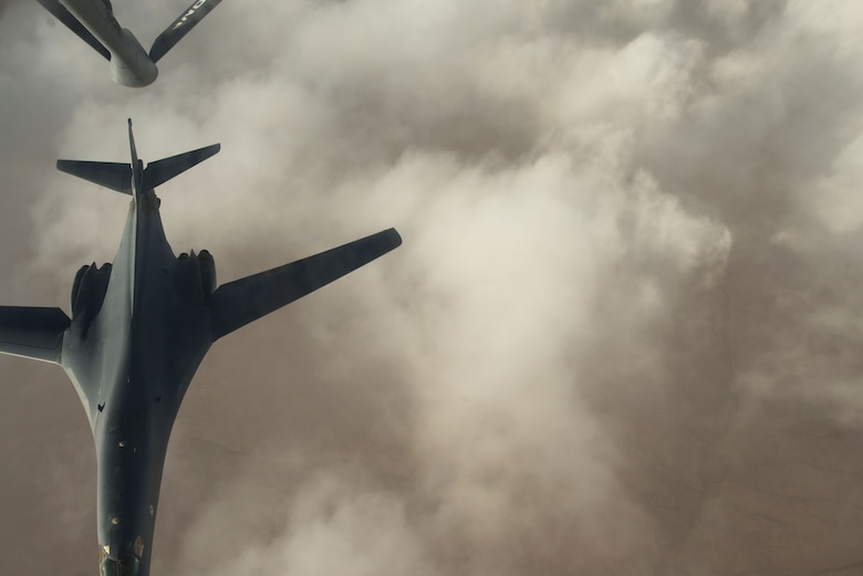 A B-1 bomber assigned to the 37th Expeditionary Bomb Squadron separates from the boom pod after receiving fuel from an Air National Guard KC-135 Stratotanker that is deployed to the 340th Expeditionary Air Refueling Squadron at Al Udeid Air Base, Qatar over Iraq, Sept. 16, 2015. (U.S. Air Force photo by Staff Sgt. Alexandre Montes/Released)