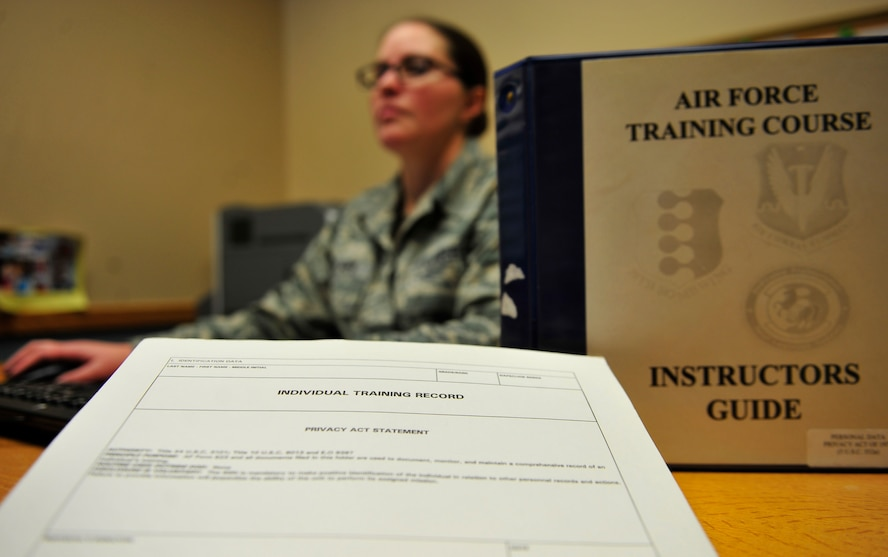 Tech. Sgt. Naomi Palmer, 28th Bomb Wing base training manager, logs training records at Ellsworth Air Force Base, S.D., Feb. 1, 2016. As base training manager Palmer keeps track of more than 600 Airmen on base who are in upgrade training. (U.S. Air Force photo by Airman 1st Class James L. Miller/Released)