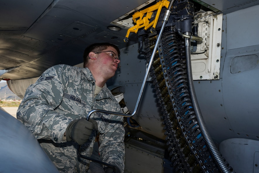 U.S. Air Force Airman 1st Class Austin Holden, a weapons load crew member assigned to the 480th Expeditionary Fighter Squadron, Spangdahlem Air Base, Germany, uses a universal ammunition loading system to load 20 mm practice rounds into an F-16 Fighting Falcon fighter aircraft during a flying training deployment on the flightline at Souda Bay, Greece, Jan. 29, 2016. The inert munitions used during the FTD simulate real conditions the 480th EFS pilots might use when engaging enemy forces. (U.S. Air Force photo by Staff Sgt. Christopher Ruano/Released)