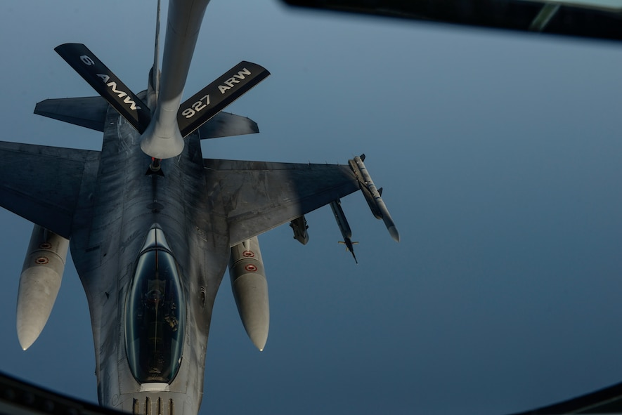 A KC-135 Stratotanker assigned to the 63rd Air Refueling Squadron, 927th Operations Group at MacDill Air Force Base, Fla., refuels an F-16 Fighting Falcon fighter aircraft assigned to the 480th Expeditionary Fighter Squadron, Spangdahlem Air Base, Germany, during a flying training deployment at Souda Bay, Greece, Feb. 2, 2016. The KC-135 extends the operational range and mission capabilities of the F-16 during the FTD. (U.S. Air Force photo by Staff Sgt. Christopher Ruano/Released)