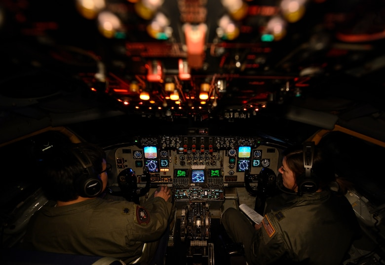 U.S. Air Force Lt. Col. Young Kim, left, and Capt. Shannon Callan, both KC-135 Stratotanker pilots assigned to the 63rd Air Refueling Squadron, 927th Operations Group at MacDill Air Force Base, Fla., begin their preflight checklist during a flying training deployment at Souda Bay, Greece, Feb. 2, 2016. The KC-135 is here in support of the 480th Expeditionary Fighter Squadron's FTD. The aircraft conducted the training as part of bilateral deployment between Greek and U.S. air forces to develop interoperability and cohesion between the partnering nations. (U.S. Air Force photo by Staff Sgt. Christopher Ruano/Released)