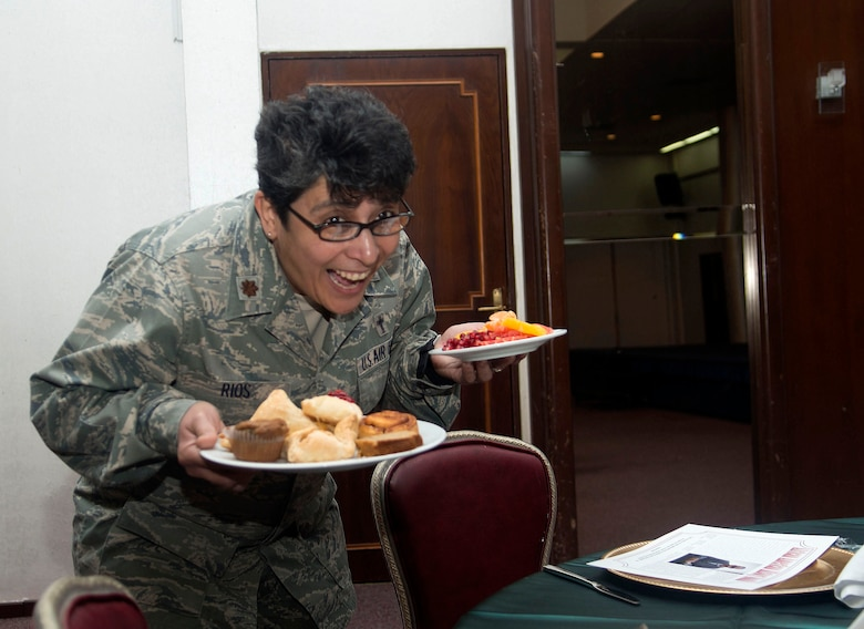 U.S. Air Force Maj. (Ch.)  Eusebia Rios, 39th Air Base Wing deputy wing chaplain, holds plates of food during an observance breakfast event at the Club Complex, Feb. 3, 2016, at Incirlik Air Base, Turkey. The observance included a gallery display of influencial African Americans throughout history and a guest speaker. (U.S. Air Force photo by Staff Sgt. Eboni Reams/Released)