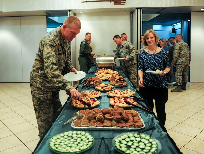 U.S. Air Force Col. John Walker, 39th Air Base Wing commander, and Mrs. Bacon, wife of U.S. Air Force Col. Thomas Bacon, 39th Medical Group commander, enjoy the buffet at an observance breakfast event at the Club Complex, Feb. 3, 2016, at Incirlik Air Base, Turkey. The buffet included a spread of baked treats and fruits as well as a photo gallery. (U.S. Air Force photo by Staff Sgt. Eboni Reams/Released)