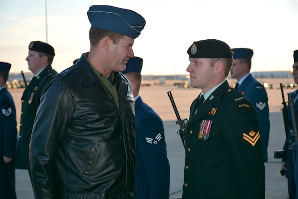 """Lt. Gen. Mike Hood, commander of the Royal Canadian Air Force, talks briefly with Master Cpl. Damien Hocquard, a communications systems operator assigned to the Canadian Detachment, which falls under the 552nd Air Control Wing, during a """"Review of Troops"""" shortly upon his arrival to Tinker Air Force Base on Tuesday. General Hood, assigned to the National Defense Headquarters in Ottawa, spent two days visiting the Canadian Detachment, which consists of 39 members of the Royal Canadian Air Force and three members of the Canadian Army. During his visit, the general met with Col. David Gaedecke, 552nd ACW commander, toured an E-3 """"Sentry"""" Airborne Warning and Control System aircraft, and held a commander's call with members of the detachment. See next week's issue of the Tinker Take Off for more coverage of the general's visit. (Air Force photo by Darren D. Heusel/Released)"""