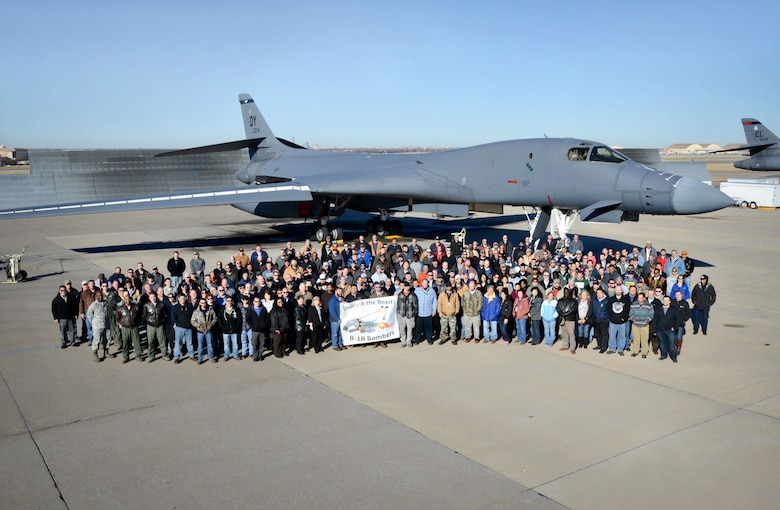 Before it leaves Tinker, members of the B-1 community pose with the 15th and final B-1B Bomber to receive the Integrated Battle Station modifications. (Air Force photo by Kelly White/Released)