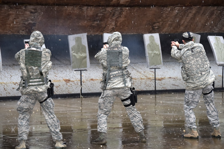 SAVANNAH CRTC, GA - Members of the 114th Security Forces Squadron shoot 9MM handguns during qualification training at the Savannah CRTC range on Feb. 4, 2016.  The rainy day didn't stop the unit members from completing their qualification training which was a part of the 114th Fighter Wings deployment to Sentry Savannah 16-1.(U.S. Air National Guard photo by Senior Master Sgt. Nancy Ausland/Released)