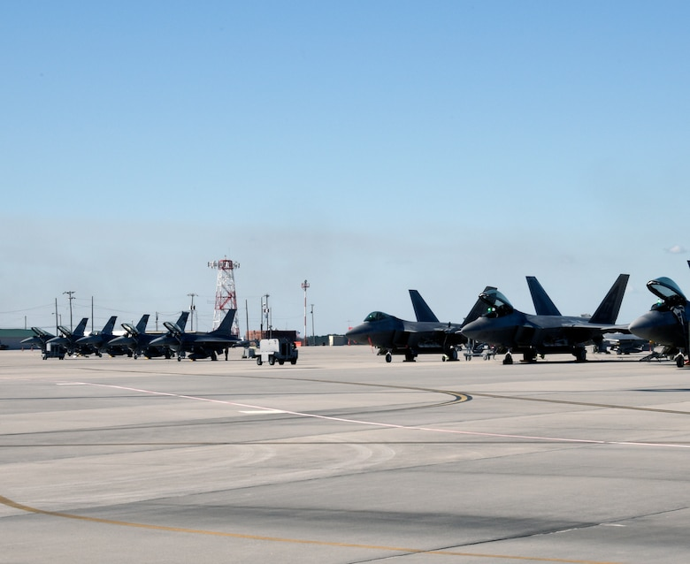 SAVANNAH CRTC, GA -  F-16's from the 114th Fighter Wing, South Dakota Air National Guard sit alongside F-22's from the 43rd Fighter Squadron, Tyndall AFB, Fl. at the Savannah CRTC Feb. 1, 2016.  The unit's participated in Sentry Savannah 16-1 exercise which brought these 4th and 5th generation aircraft together to train.(U.S. Air National Guard photo by Senior Master Sgt. Nancy Ausland/Released)