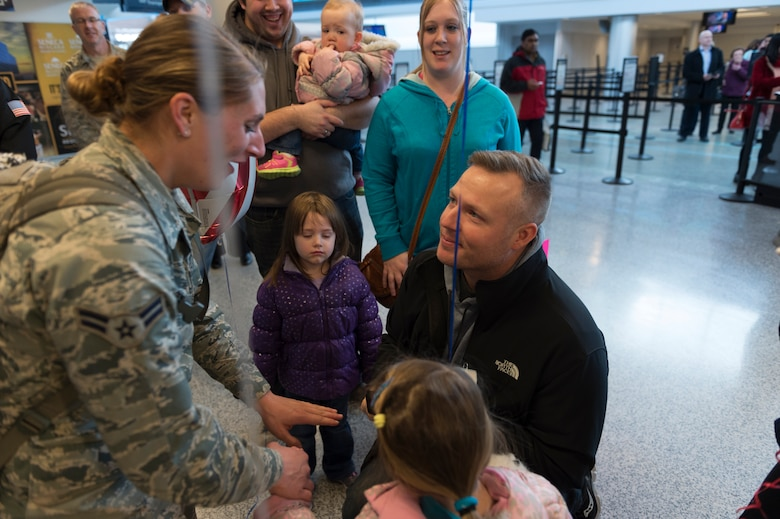 Justin Jurs surprises Airman 1st Class Amanda Lavocat, an Airman assigned to the 107th Security Forces Squadron, Niagara Falls Air Reserve Station, N.Y., by proposing to her upon her arrival home from a deployment. Lavocat was one of more than 30 Airmen from the 107th SFS to return from a six-month deployment to Southwest Asia, Feb. 4-5, 2016. (U.S. Air National Guard photo by Staff Sgt. Ryan Campbell/Released)