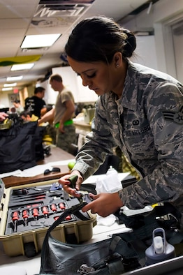 U.S. Air Force Senior Airman Alyssa Uribe, 144th Operations Group aircrew flight equipment technician, conducts a routine inspection on a harness as part of Red Flag 16-1 held at Nellis Air Force Base, Nev. Feb. 3, 2016. Uribe and the rest of the 144th OG AFE team complete thorough inspections on all the 194th Fighter Squadron pilots' flight equipment before every mission to ensure the safest flight every time. (U.S. Air National Guard photo by Senior Airman Klynne Pearl Serrano)