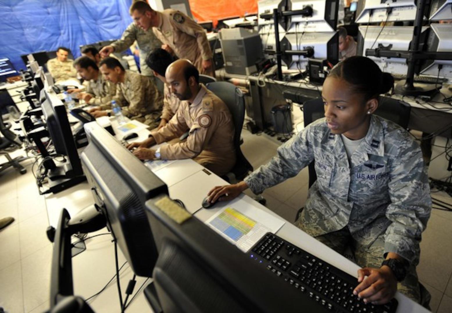 Capt. Mechell Dotson serves as the host nation air operations center liaison during Arabian Gulf Shield, Feb. 3, 2016, at the Combined Air Operations Center, Al Udeid Air Base, Qatar. (U.S. Air Force photo by Master Sgt. Joshua Strang)
