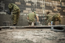 Service members with the Royal Thai Navy, Japan Ground Self-Defense Force and U.S. Marines with Marine Wing Support Squadron 171 help build a multipurpose room at the Ban Cham Kho School, in Rayong, Thailand, exercise Cobra Gold, Feb. 4, 2016. Cobra Gold 2016, in its 35th iteration, includes a specific focus on humanitarian civic action, community engagement and medical activities conducted during the exercise to support the needs and humanitarian interests of civilian populations around the region.