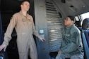 Capt. Brian, an 816th Expeditionary Airlift Squadron C-17 Globemaster III pilot, gives Master Sgt. Janine Obando, 379th Air Expeditionary Wing Equal Opportunity Office director, a tour of a C-17 Globemaster III Jan. 29 at Al Udeid Air Base, Qatar. As the 379 AEW's EO director, Obando is required to visit with commanders and service members in their work centers to ensure they know the services the EO office provides. Brian is an aircraft commander deployed from Dover Air Force Base, Delaware. (U.S. Air Force photo by Tech. Sgt. James Hodgman/Released)