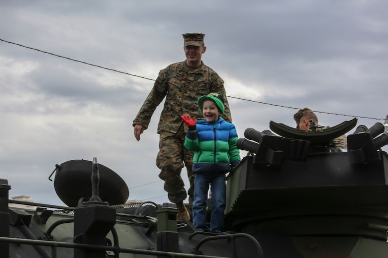 Corporal Nicholas J. Cascone, an assault amphibious vehicle crewman with 2nd Assault Amphibian Battalion, and Lucas Lynn, son of Matthew Lynn, a Jacksonville resident, stand atop an AAV following the 2nd Marine Division's 75th anniversary parade in downtown Jacksonville, N.C., Feb. 6, 2016. The celebration serves as a time to remember the Marines and sailors who served and continue to serve in 2nd Marine Division, while thanking the local community for their support. (U.S. Marine Corps photo by Cpl. Paul S. Martinez/Released)