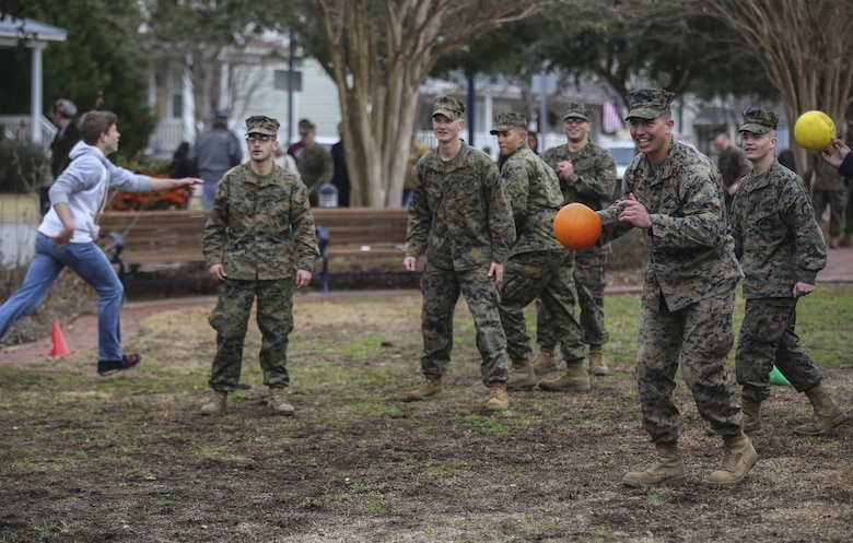 Corporal Caleb Sevier, a combat engineer with 2nd Combat Engineer Battalion, 2nd Marine Division, plays a game of dodgeball alongside Marines and community members following the Division's 75th anniversary parade in downtown Jacksonville, N.C., Feb. 6, 2016. The celebration serves as a time to remember the Marines and sailors who served and continue to serve in 2nd Marine Division, while thanking the local community for their support. (U.S. Marine Corps photo by Cpl. Paul S. Martinez/Released)