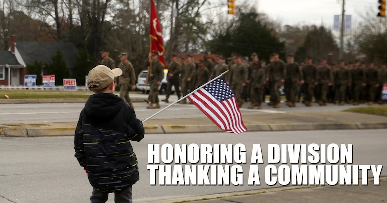 A young boy watches as Marines and sailors with 2nd Marine Division march by in the unit's 75th anniversary parade in downtown Jacksonville, N.C., Feb. 6, 2016. The celebration serves as a time to remember the Marines and sailors who served and continue to serve in 2nd Marine Division, while thanking the local community for their support. (U.S. Marine Corps photo by Cpl. Joey Mendez/Released)