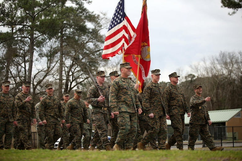 Maj. Gen. Brian D. Beaudreault, commanding general of 2nd Marine Division, and fellow leaders of the unit point and smile at friends and family during the unit's 75th anniversary parade in downtown Jacksonville, N.C., Feb. 6, 2016. The celebration serves as a time to remember the Marines and sailors who served and continue to serve in 2nd Marine Division, while thanking the local community for their support. (U.S. Marine Corps photo by Cpl. Joey Mendez/Released)