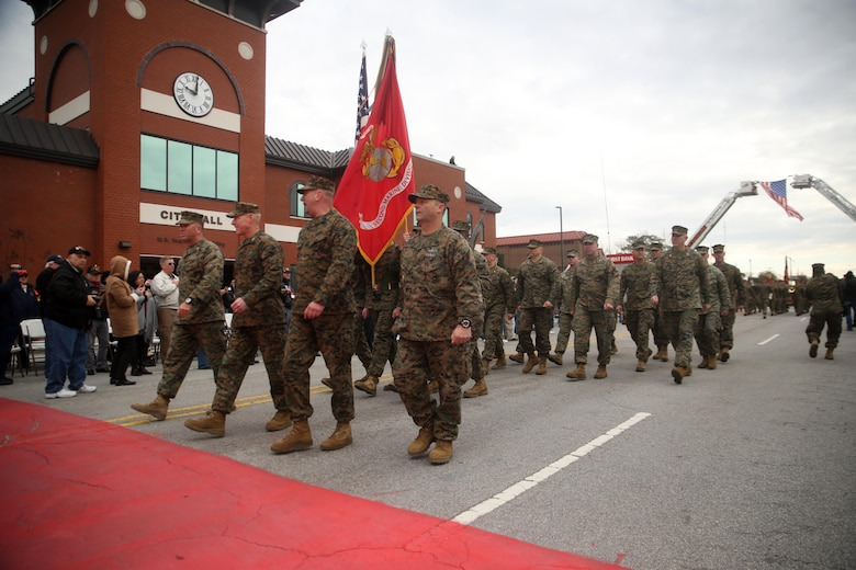 Maj. Gen. Brian D. Beaudreault, commanding general of 2nd Marine Division, flanked by fellow leaders of the unit, marches past City Hall during the unit's 75th anniversary parade in downtown Jacksonville, N.C., Feb. 6, 2016. The celebration serves as a time to remember the Marines and sailors who served and continue to serve in 2nd Marine Division, while thanking the local community for their support. (U.S. Marine Corps photo by Cpl. Joey Mendez/Released)