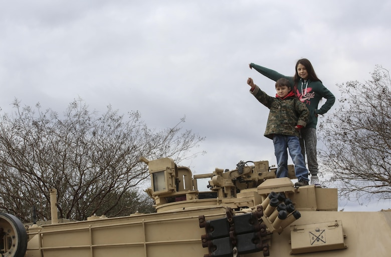 Katlyn Tameling, right, and Easton Tameling, left, children of Gunnery Sgt. Jason Tameling, a platoon sergeant with 2nd Assault Amphibian Battalion, stand atop an M1A1 Abrams tank following the 2nd Marine Division's 75th anniversary parade in downtown Jacksonville, N.C., Feb. 6, 2016. The celebration serves as a time to remember the Marines and sailors who served and continue to serve in 2nd Marine Division, while thanking the local community for their support. (U.S. Marine Corps photo by Cpl. Paul S. Martinez/Released)