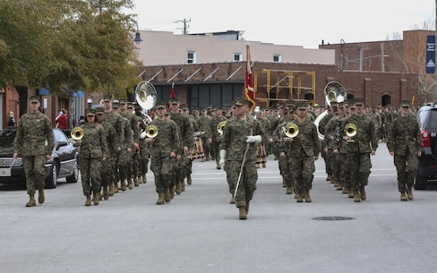 The 2nd Marine Division Band enters Riverwalk Crossing Park during the 2nd Marine Division's 75th anniversary parade in downtown Jacksonville, N.C., Feb. 6, 2016. The celebration serves as a time to remember the Marines and sailors who served and continue to serve in 2nd Marine Division, while thanking the local community for their support. (U.S. Marine Corps photo by Cpl. Paul S. Martinez/Released)