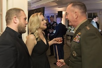 "Marine Corps Gen. Joseph F. Dunford Jr., right, chairman of the Joint Chiefs of Staff, speaks with country music singer Kellie Pickler and her husband, country music songwriter Kyle Jacobs, at the USO 75th anniversary reception in Washington, D.C., Feb. 4, 2016. Dunford delivered keynote remarks at the event. Other attendees included Dr. Jill Biden, actor Dennis Haysbert, and ""Jeopardy!"" host Alex Trebek. DoD photo by Navy Petty Officer 2nd Class Dominique A. Pineiro"