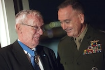 Marine Corps Gen. Joseph F. Dunford Jr., right, chairman of the Joint Chiefs of Staff, speaks with a Medal of Honor recipient at the USO 75th anniversary reception in Washington, D.C., Feb. 4, 2016. DoD photo by Navy Petty Officer 2nd Class Dominique A. Pineiro