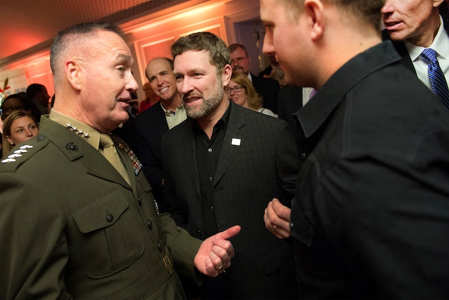 Marine Corps Gen. Joseph F. Dunford Jr., left, chairman of the Joint Chiefs of Staff, speaks with country music singer and Army veteran Craig Morgan, center, at the USO 75th anniversary reception in Washington, D.C., Feb. 4, 2016. DoD photo by Navy Petty Officer 2nd Class Dominique A. Pineiro