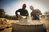 U.S. Marine Corps Lance Cpl. Jack Cyrone, left, and Lance Cpl. Tyler Cox, right, both combat engineers with the Marine Wing Support Squadron 171, help build a multipurpose room at the Ban Cham Kho School, in Rayong, Thailand, Exercise Cobra Gold, Feb. 4, 2016. Cobra Gold 2016, in its 35th iteration, includes a specific focus on humanitarian civic action, community engagement and medical activities conducted during the exercise to support the needs and humanitarian interests of civilian populations around the region.