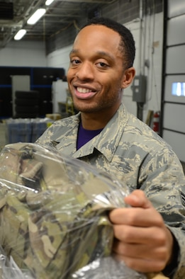 Senior Airman William Greene IV, assigned to the traffic management office,175th Logistic Readiness Squadron, unpacks new Air Force equipment at Warfield Air National Guard Base in Baltimore Dec. 4, 2015. Green, who processes inbound parcels for the entire base, was selected as the Spotlight Airman for the month of February in the Maryland Air National Guard.(U.S. Air National Guard photo by Tech. Sgt. David Speicher/RELEASED)