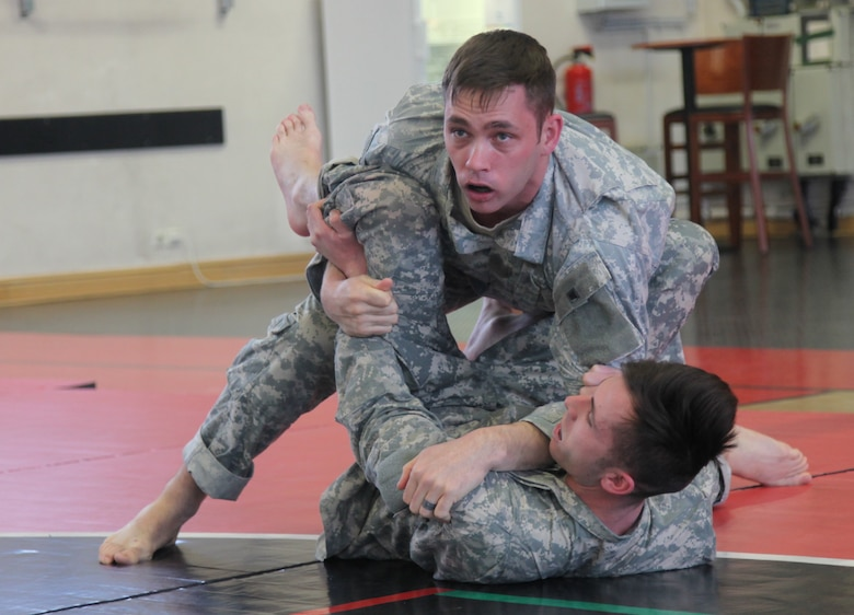 KAISERSLAUTERN, Germany-Center top, Staff Sgt. Joshua Barnes grapples with Spc. Bryan Hauenstein during battle drills at the 7th Mission Support Command led tactical combatives course Feb. 4, 2016 at Kleber Fitness Center. Barnes and Hauenstein, both members of the 92nd Military Police Company as well as other students from around the Kaiserslautern Military Community were participating in the culminating event of a two-week long tactical combatives training.