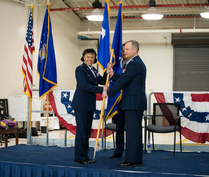 Major General Stayce D. Harris, Commander of the 22nd Air Force, Dobbins Air Reserve Station, GA, hands off the Wing flag to Colonel Brian S. Bowman as he assumes command of the 914th Airlift Wing, Niagara Falls Air Reserve Station, N.Y., February 6, 2016. (U.S. Air Force photo by Tech. Sgt. Stephanie Sawyer)