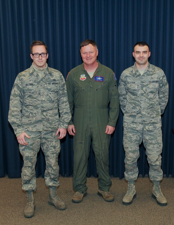 Staff Sgt. Ethan Dellman,114th Maintenance Squadron ammunitions, and Staff Sgt. Zach Hollstrom, 114th Operation Support Squadron aviation resource management, received recognition from Col. Russ Walz, 114th Fighter Wing commander, during a ceremony held at Joe Foss Field, S.D. Jan. 10, 2016.  Both Airmen received the Distinguished Graduate award at Airman Leadership School.  This award is given to Airmen who graduate in the top 10 percent of their class. (U.S. Air National Guard photo by Staff Sgt. Duane Duimstra)