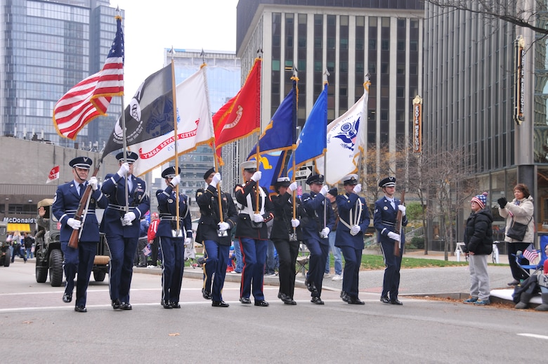 A joint service color guard, including members of the 171st Air Refueling Wing, march in the Veterans' Parade. The Pennsylvania National Guard joined with the Pennsylvania Department of Conservation of Natural Resources' Point State Park and the Association of the United States Army to organize Steel City Salutes the Troops, Pittsburgh, Nov. 7, 2015.  (U.S. Air National Guard Photo by Staff Sgt. Ryan Conley)