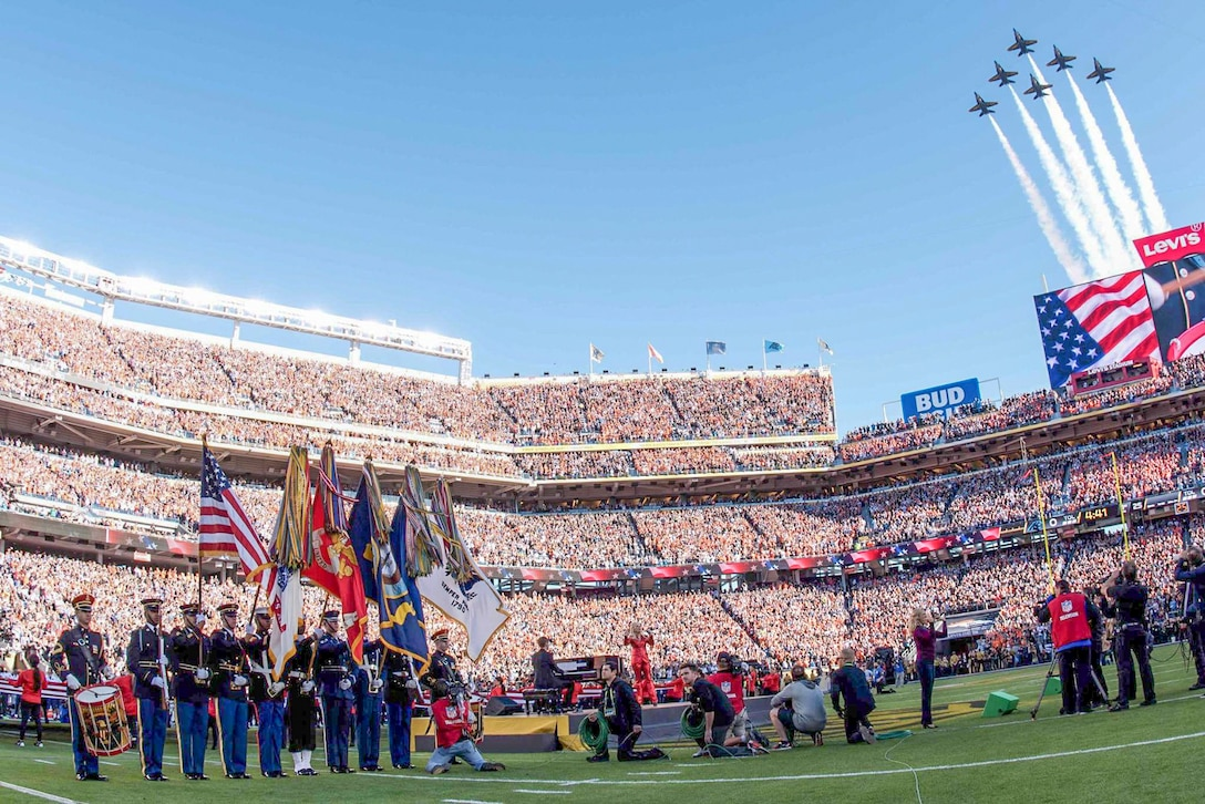 The Blue Angels, the Navy's flight demonstration squadron, perform a flyover concluding the opening ceremony of Super Bowl 50 at Levi's Stadium in Santa Clara, Calif., Feb. 7, 2016. A joint armed forces choir performed during the ceremony and a joint armed forces color guard presented the colors. Army photo by Spc. Brandon C. Dyer