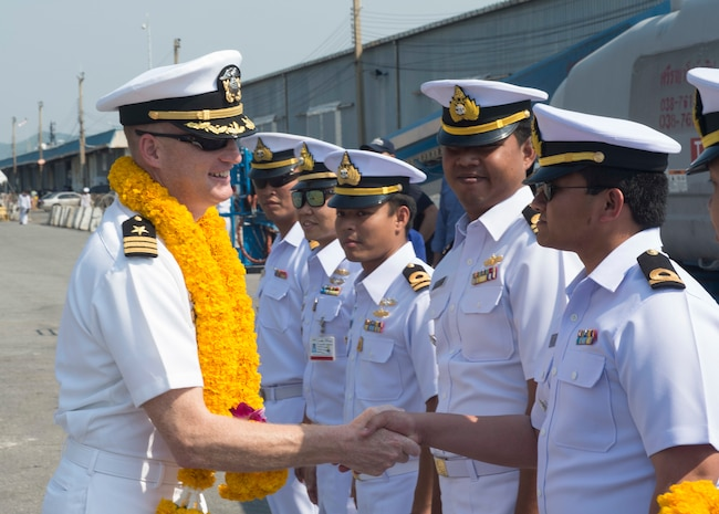 160205-N-RM689-232 SATTAHIP, Thailand (Feb. 05, 2016)- Cmdr. Daniel P. Duhan, left, commanding officer of amphibious dock landing ship USS Ashland (LSD 48), greets members of the Royal Thailand Navy during a tour. Ashland is assigned to the Bonhomme Richard Amphibious Ready Group, and is participating in exercise Cobra Gold 16, a Thai-U.S. co-sponsored multinational joint exercise designed to advance regional security by exercising a robust multinational force from nations sharing common goals and security commitments in the Indo-Asia-Pacific region.