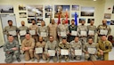 Lt. Gen. Charles Q. Brown (2nd row, center), commander, U.S. Air Forces Central Command, poses for a photo with Liaison Officer (LNO) students and training leadership during a graduation ceremony, Feb. 4, 2016, in the Combined Air Operations Center, Al Udeid Air Base, Qatar. The ceremony recognized the achievement of the students completion of the Gulf Cooperation Council (GCC) LNO Program and the Senior Operations Planner Program. Both programs improve interoperability and furthers relations within the GCC and the U.S. air and air defense community. (U.S. Air Force photo by Master Sgt. Joshua Strang)