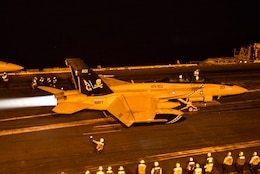 "(Dec. 28, 2015) An F/A-18F Super Hornet, assigned to the ""Jolly Rogers"" of Strike Fighter Squadron (VFA) 103, launches from the flight deck of the aircraft carrier USS Harry S. Truman (CVN 75). The Harry S. Truman Carrier Strike Group is deployed in support of maritime security operations and theater security cooperation efforts in the U.S. 5th Fleet area of operations."