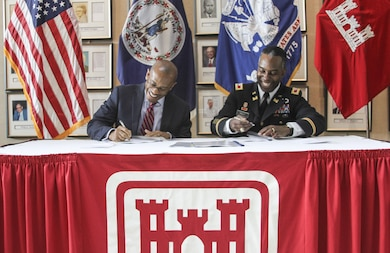 Marcus Jones, Norfolk city manager and Col. Jason Kelly, Norfolk District commander  sign the Feasibility Coast Share Agreement for the Norfolk flood risk management study on February 3, 2016. The agreement allows the Norfolk District to take a comprehensive look at the city of Norfolk to identify potential areas that projects could be constructed to protect the city from flooding and sea-level rise. (U.S. Army photo/Kerry Solan)